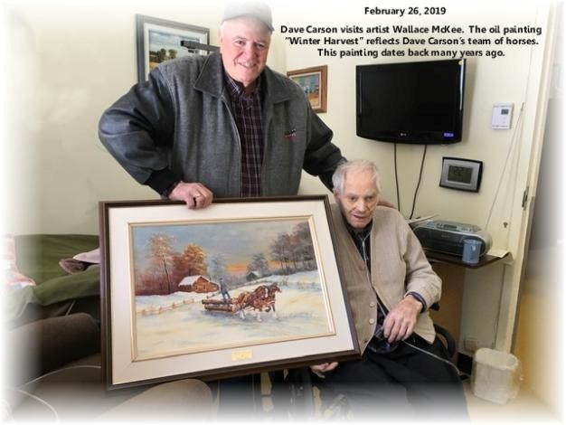 two elderly men posing with a painting of a farm during window
